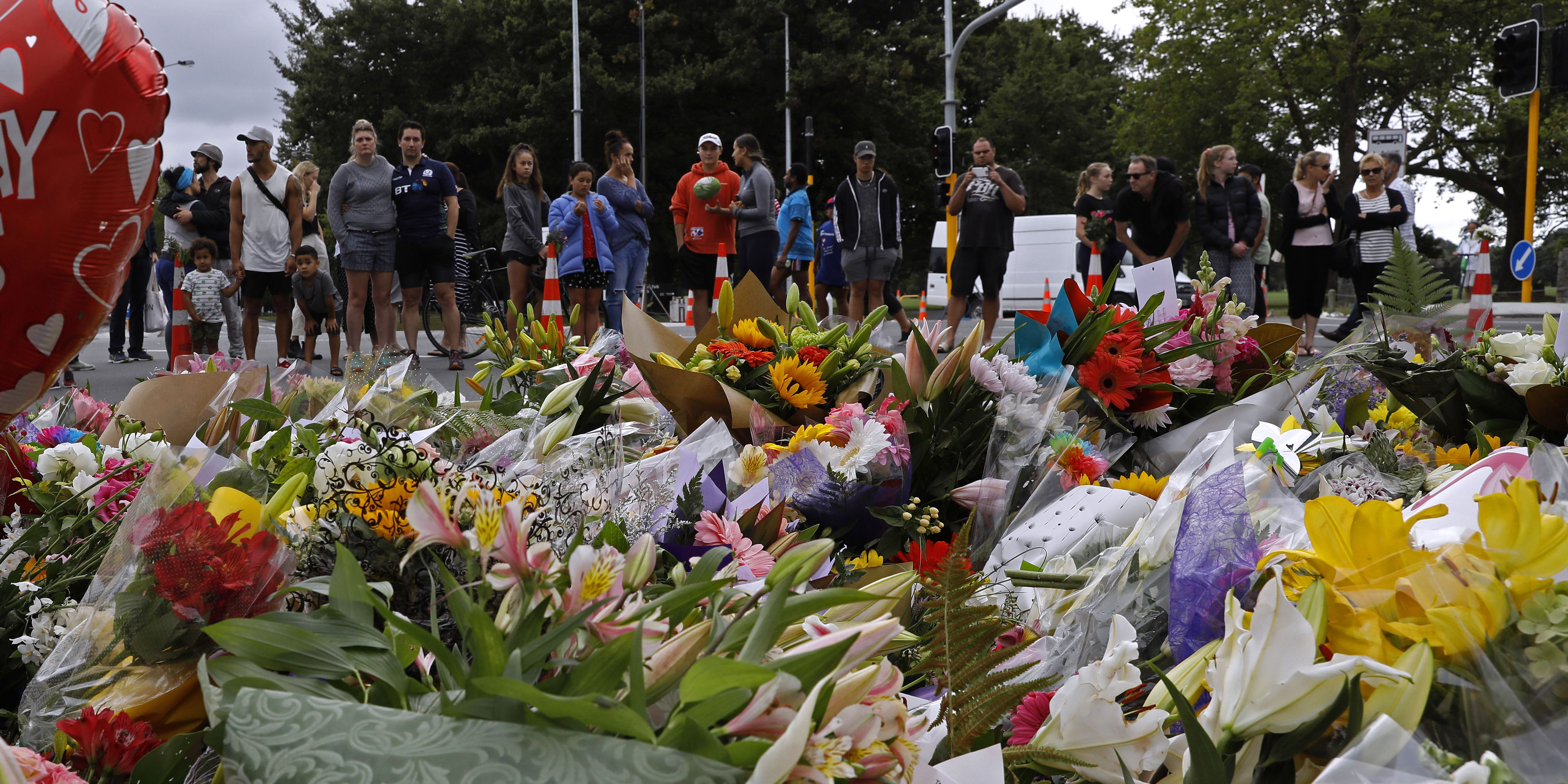 Death toll rises to 50, as stricken New Zealanders reach out to Muslims after shooting
